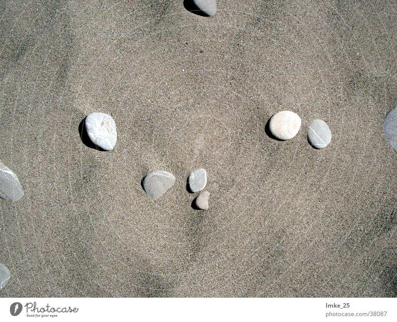Steine im Sand Meer Strand Stein Sand Hintergrundbild Stranddüne Kies Türkei