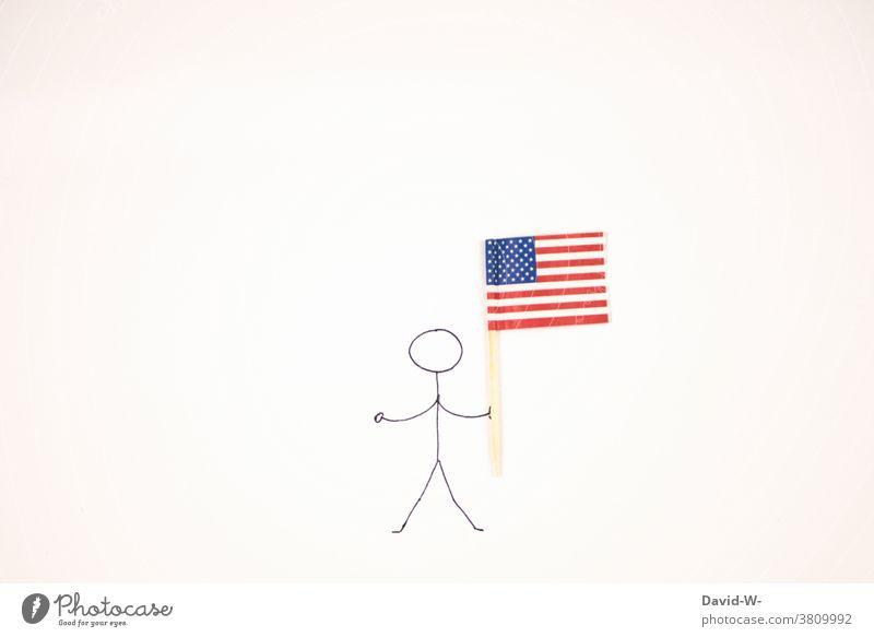 Strichmännchen mit Amerikanischer Flagge in der Hand Patriot USA Amerikaner Fahne national Stars and Stripes Mann festhalten