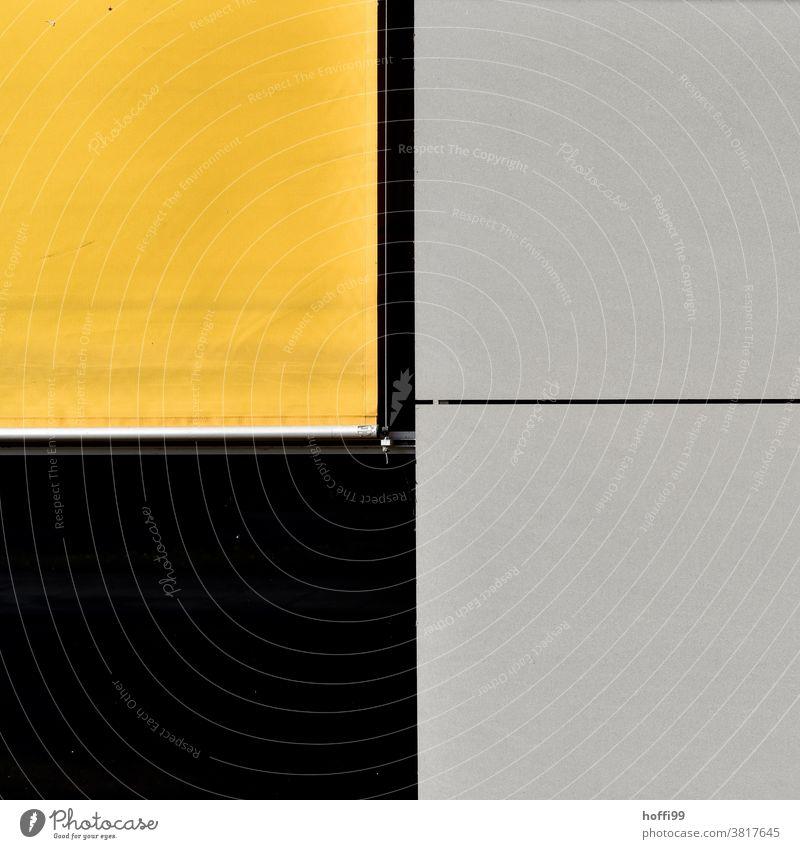 gelbes Rollo mit schwarzem und grauen Fassadenelementen minima Minimalismus Fassadenverkleidung Architektur abstrakter Hintergrund abstraktes Design