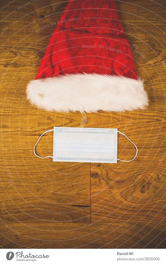 Corona und Weihnachten - Nikolasumütze und Atemschutzmaske Maske Nikolausmütze weihnachtszeit adventszeit pandemie Prävention COVID