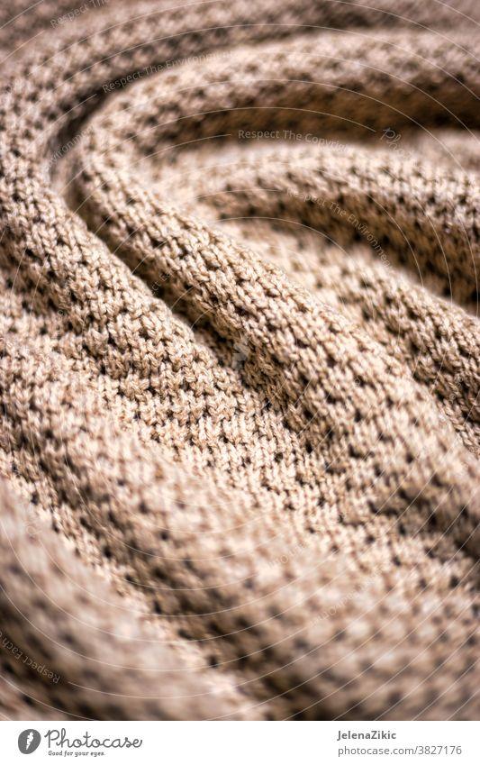 Gestrickte beige Deckentextur Hintergrund stricken Muster warm Textur Wolle Mode Makro Wollstoff gewebt Kaschmiri weich Gewebe Faser Winter dekorativ natürlich