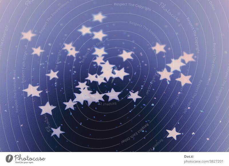 Sterne verstreut leuchtend Hintergrund dekorativ viele blau