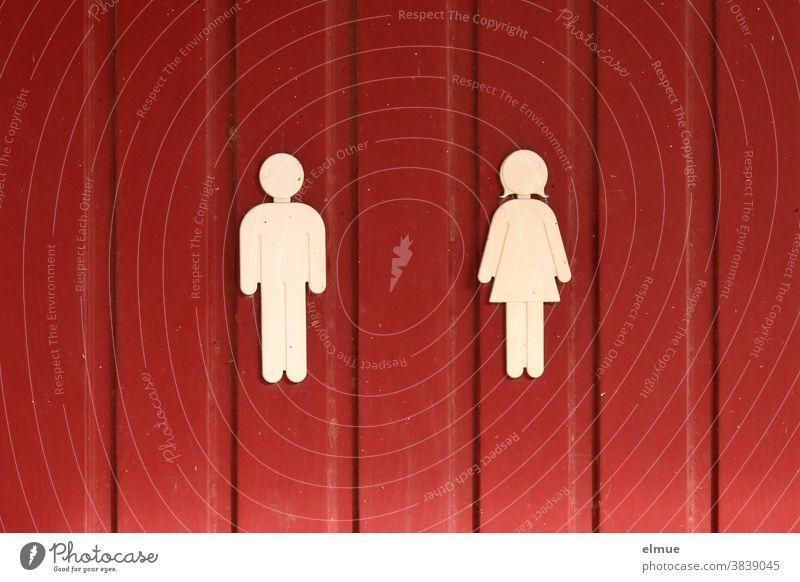Weiße Piktogramme von Mann und Frau an einer roten Holztür Frau und Mann unisex Tür abstrakt Abstraktion Sinnbild Symbolik Schild Codes Bildsprache Bildzeichen