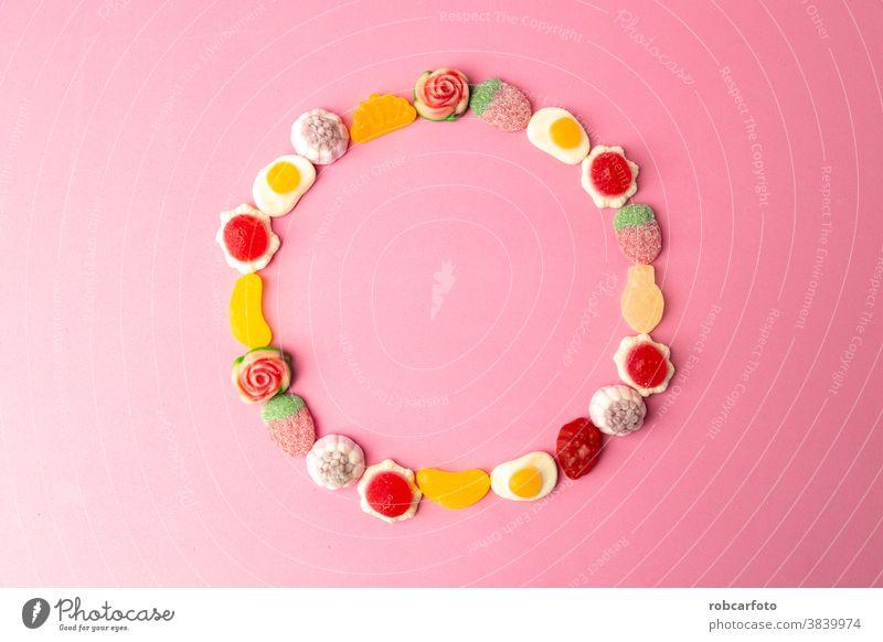 Kandiszucker, Zucker auf rosa Hintergrund Lebensmittel farbenfroh süß Dessert Bonbon Nahaufnahme Konditorei Feiertag hell Farbe orange lecker rot Menschengruppe
