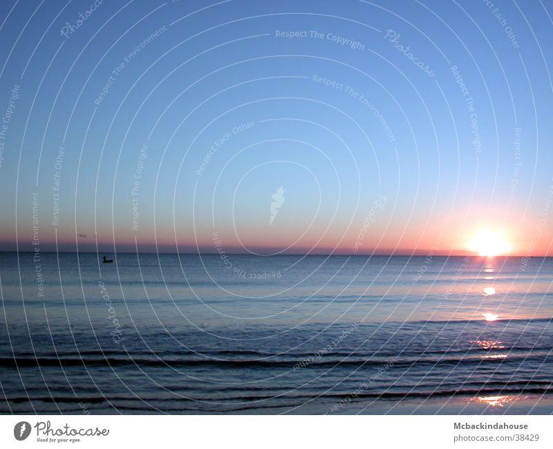 Meer-Sonnenaufgang Strand Ferien & Urlaub & Reisen ruhig Licht Wellen Frieden blau