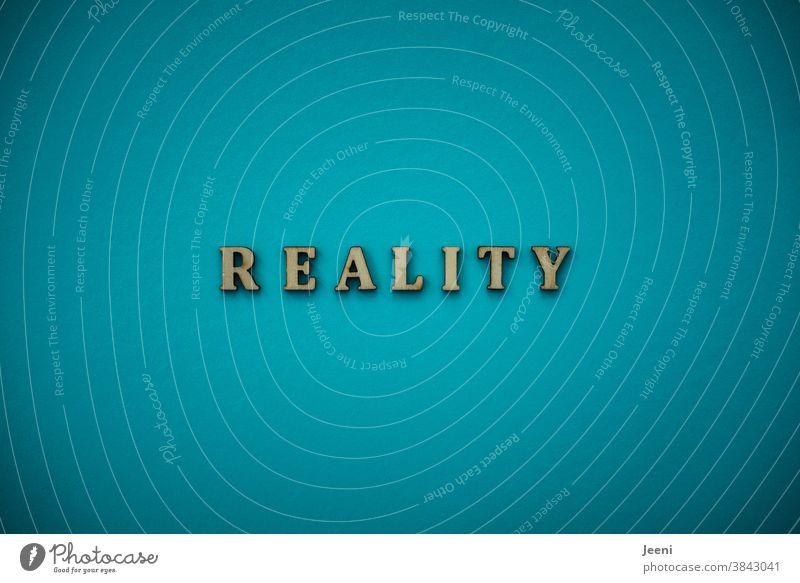 REALITY - Realität | Text auf einfarbigem Hintergrund in türkis-blau reality wirklich Wirklichkeit Tatsache Gegebenheit grell hell Farbfoto leuchten
