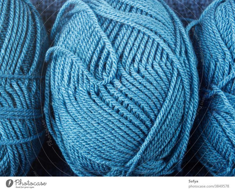 Hintergrund mit blauer Wollstrickgarntextur stricken Wolle Garn Winter Textur Makro Handarbeit Hobby Nadeln Strickwaren weich heimwärts Werkzeuge Pflege Pastell
