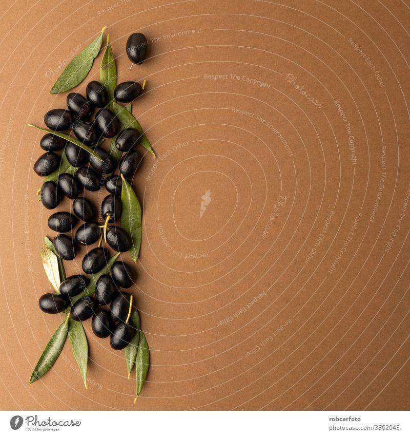 schwarze Oliven Hintergrund brauner Hintergrund Lebensmittel Bestandteil organisch reif Ackerbau Frucht frisch glänzend Gesundheit mediterran grün Vegetarier