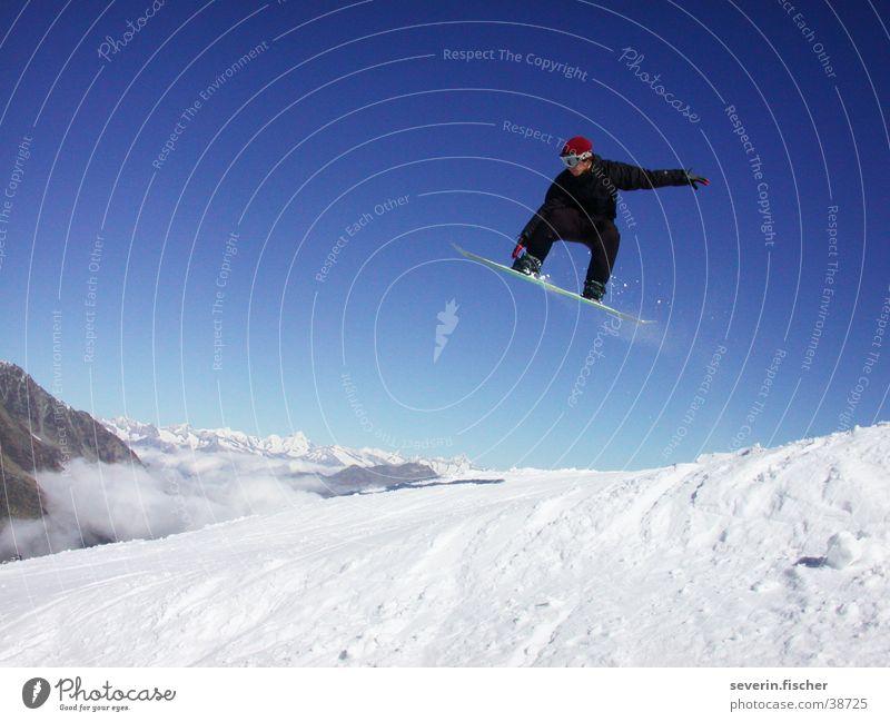 Jibber Schweiz Winter Kanton Wallis Snowboarding Straight Jump springen Sport Saas Fee Grap Berge u. Gebirge Schnee Air Snowboarder Trick Jump