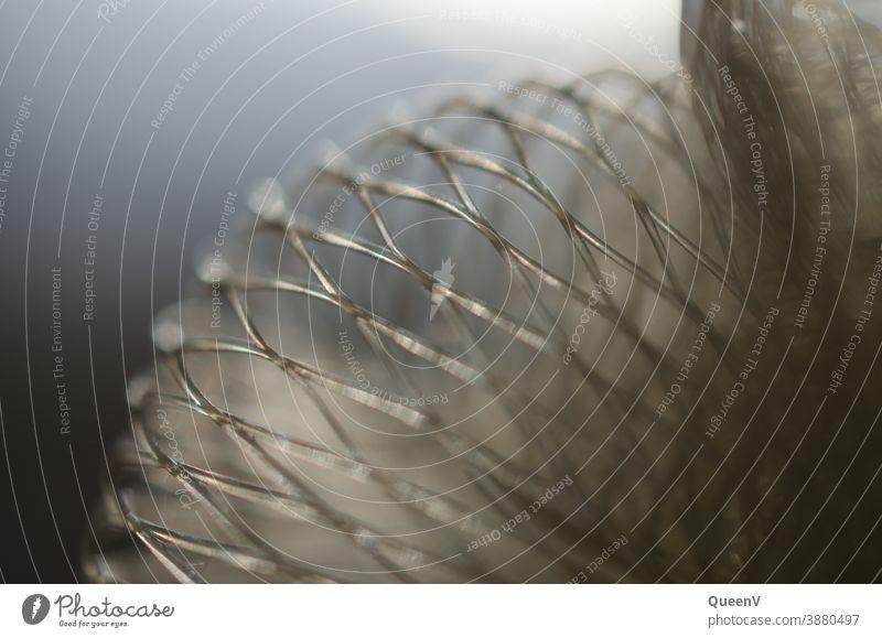 Netzschwamm Nahaufnahme mit einem idyllische Licht Duschschwamm Seife Schwamm weiß grau Reinigen Sauberkeit Makroaufnahme Kunststoff Strukturen & Formen
