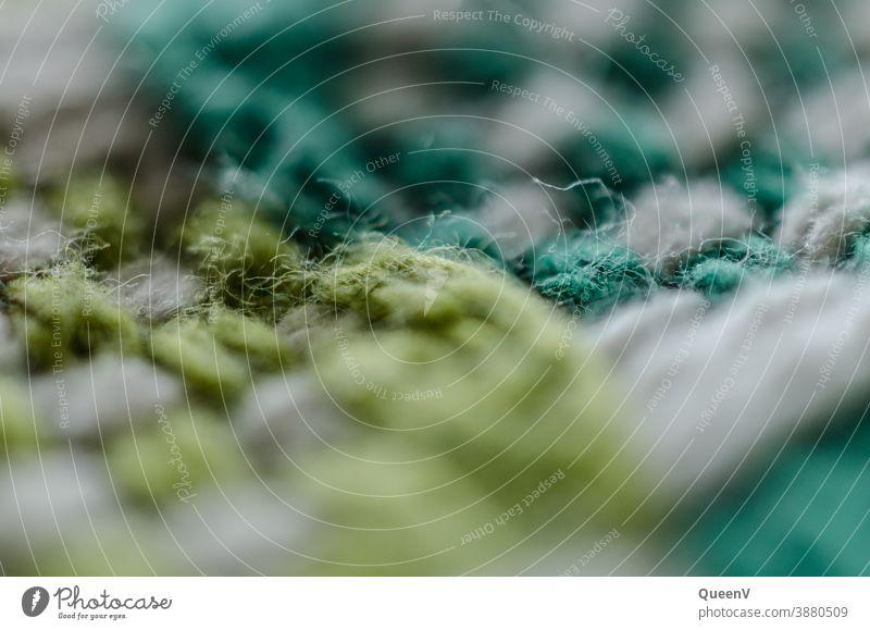 Nahaufnahme von Stoff mit Grüne Farben weiß grün Faser Warm flechten stricken Wolle Bekleidung weich Material Textil Design Textur Gewebe Produktion Mode