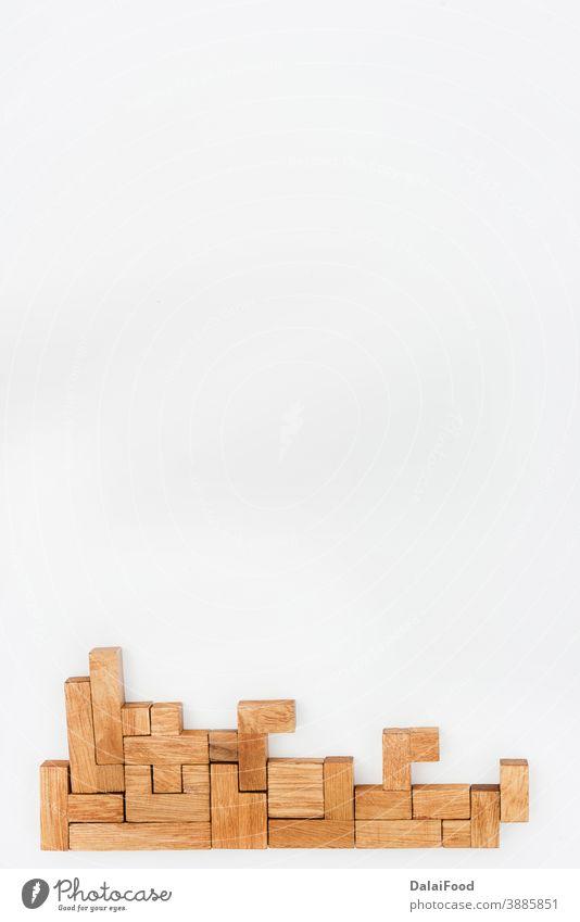 Hölzerne Puzzleteile als Hintergrund Business Herausforderung Konzept verbinden Anschluss errichten Konstruktion leer Spiel Menschengruppe Idee vereinzelt