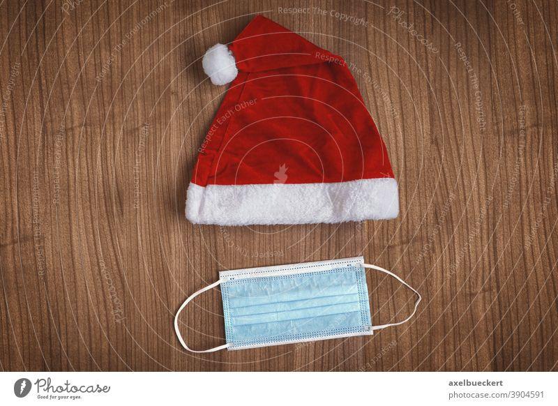 Corona Weihnachten mit Weihnachtsmannmütze und Mundschutz Corona-Weihnachten Weihnachtsmütze Maske Mund-Nasen-Schutz COVID-19 Gesichtsmaske Korona-Weihnachten