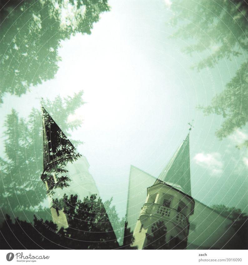 Doppelspitze Kirche Kirchturm Kirchturmspitze Glaube Religion & Glaube religion analog cross Cross Processing Holga Lomografie Himmel Dia Scan Doppelbelichtung