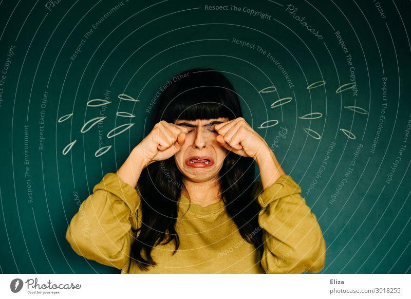 Junge Frau ist traurig und vergießt viele (gemalte) Tränen weinen untröstlich heulen Trauer lustig witzig überzeichnet übertrieben beleidigt Traurigkeit