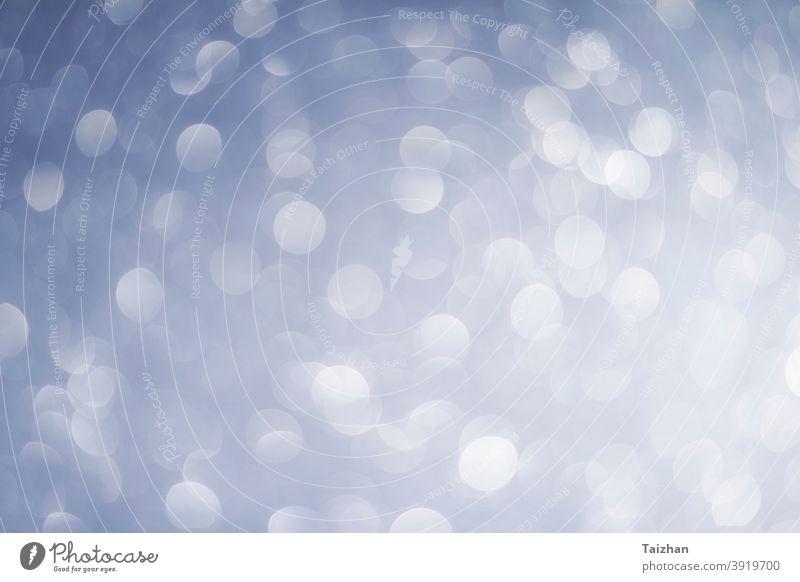 abstrakte Unschärfe weiß, blau und silberne Farbe Hintergrund mit Stern glitzernde Licht Schneeflocke Glamour Glitter glühend glänzend defokussiert Muster