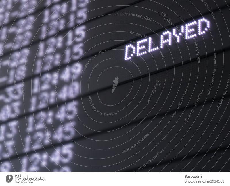 """Anzeige """"DELAYED"""" auf einem Flughafen Tourismus Flugzeug Ankunft Urlaub Luftverkehr Verkehr Ferien & Urlaub & Reisen Farbfoto fliegen Passagierflugzeug"""