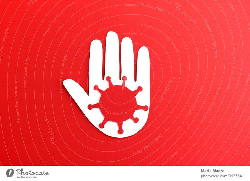 Vorsicht Corona - Illustration einer Hand mit rotem Corona-Virus Symbol corona Symbole & Metaphern Grafik u. Illustration Papierschnitt rosa Warnung Stop