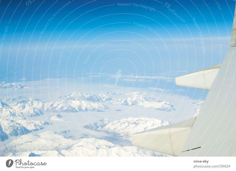 heaven, i'm in heaven ... Flugzeug Wolken Tragfläche Ferne Luftverkehr Himmel Sonne blau Alpen Berge u. Gebirge Schnee