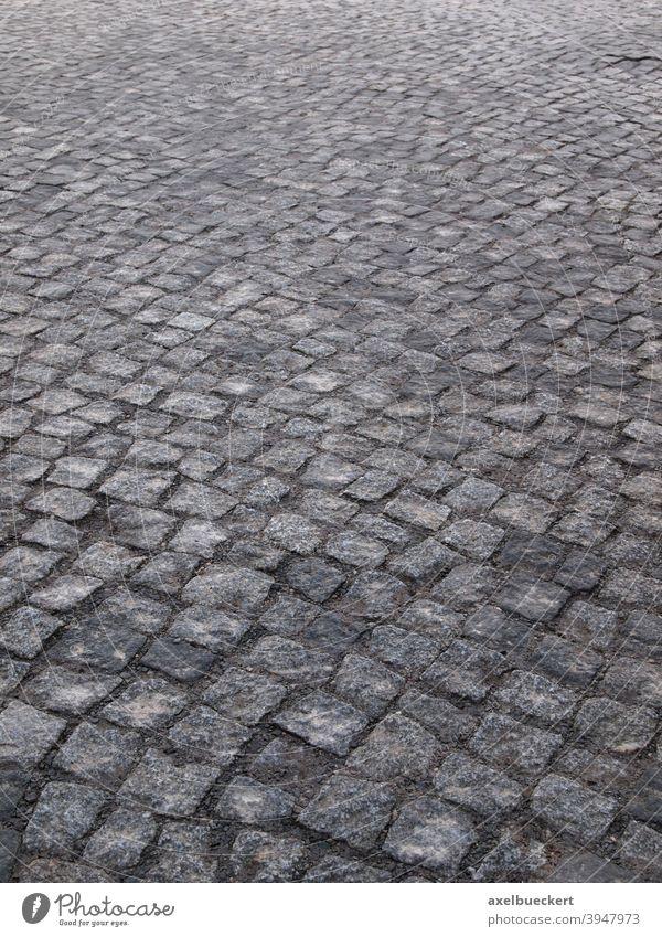 Kopfsteinpflaster Straße Straßenpflaster Straßenbelag Pflastersteine abstrakt gepflastert grau Muster Stein Wege & Pfade Verkehrswege Menschenleer