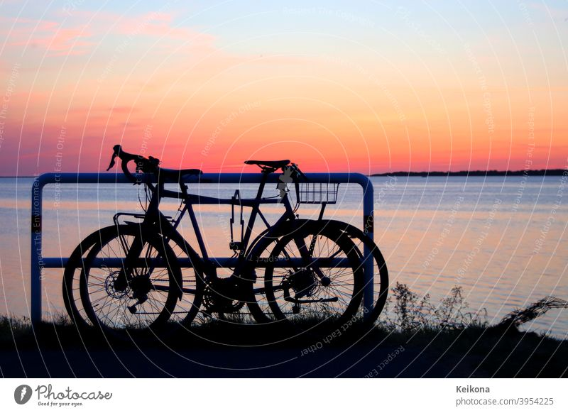 Parked bicycles on sea shore. Sunset environment. active adventure background baltic baltic sea bicycling bike biking coast competition deutschland europe