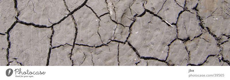 Seeboden Wasser braun Riss Lehm Seegrund