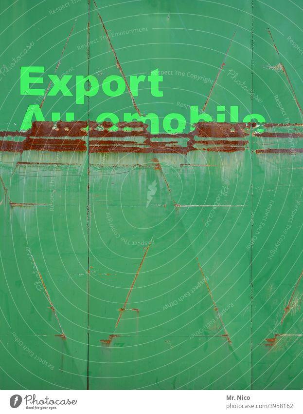 Exportgeschäft export Autohaus autohandel Tor grün automobil Garage Schriftzeichen Rost rostig Garagentor Hinweisschild Schilder & Markierungen Einfahrt
