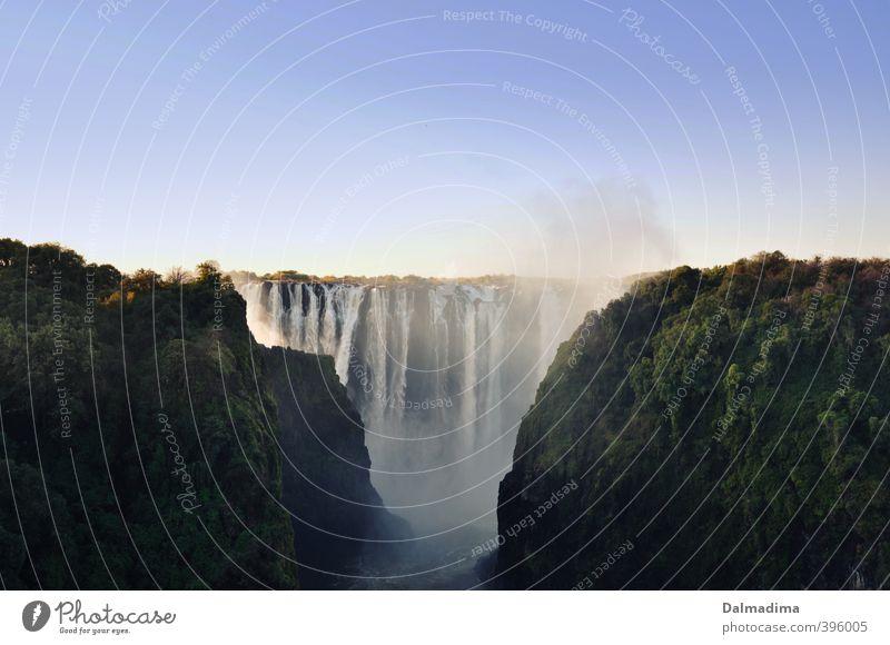 Victoria Falls Zambia Himmel Natur Ferien & Urlaub & Reisen schön Wasser Sommer Landschaft Wald Umwelt Felsen Luft Idylle Klima Tourismus Schönes Wetter