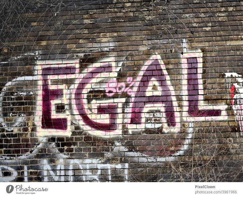 Graffiti Wand Außenaufnahme Straßenkunst Jugendkultur Schmiererei Fassade Schriftzeichen Subkultur Mauer Wort Buchstaben Egal