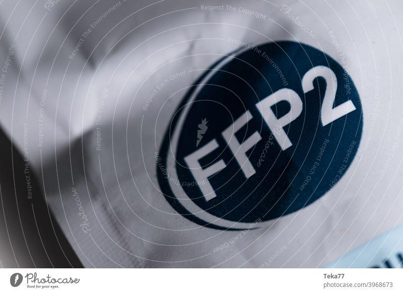 eine ffp2-Gesichtsmaskenverpackung CE Gesichtsschutzmaske ffp2 Schutzmaske europäisch getestet Coronavirus Gefahr Sicherheit Mundschutz ffp2-Maske