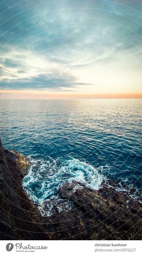friedlicher Sonnenuntergang Strand und Meer MEER winken Felsen Frieden Himmel Wolken emotional frisch Pastell Natur Teneriffa Spanien holliday