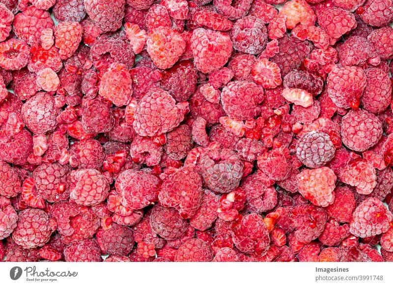 Gefrorene Himbeeren Hintergrund von oben Hintergründe Beeren Beerenfrüchte Nahaufnahme kalt kalte Temperatur Farbbild Obst Produkt Dessert top view Essen