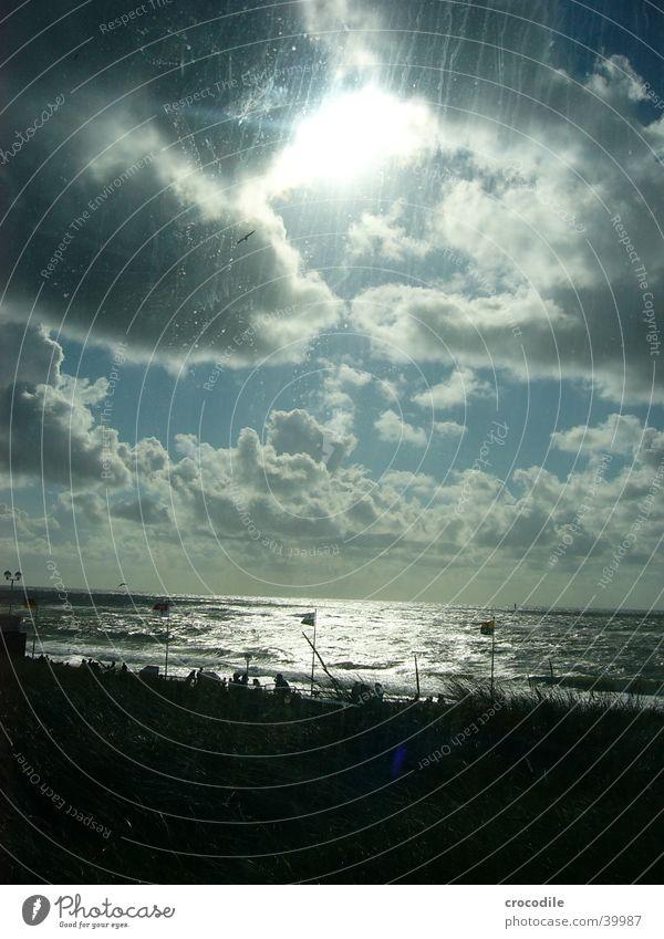 Sun breaking through Mensch Sonne Meer blau Strand Ferien & Urlaub & Reisen Wolken hell Vogel Wellen Deutschland Wind Sturm Nordsee Sylt Westerland