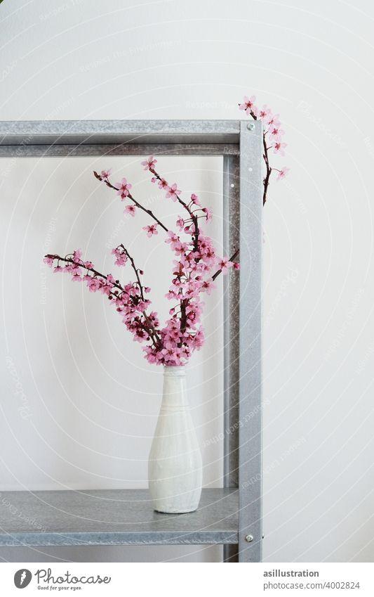 Frühlingszweig Zweig rosa interior Dekoration Vase Blumenvase Vintage Blüte aufblühen zart schön Blühend Innenaufnahme schlicht Farbfoto Blütezeit Pflanze