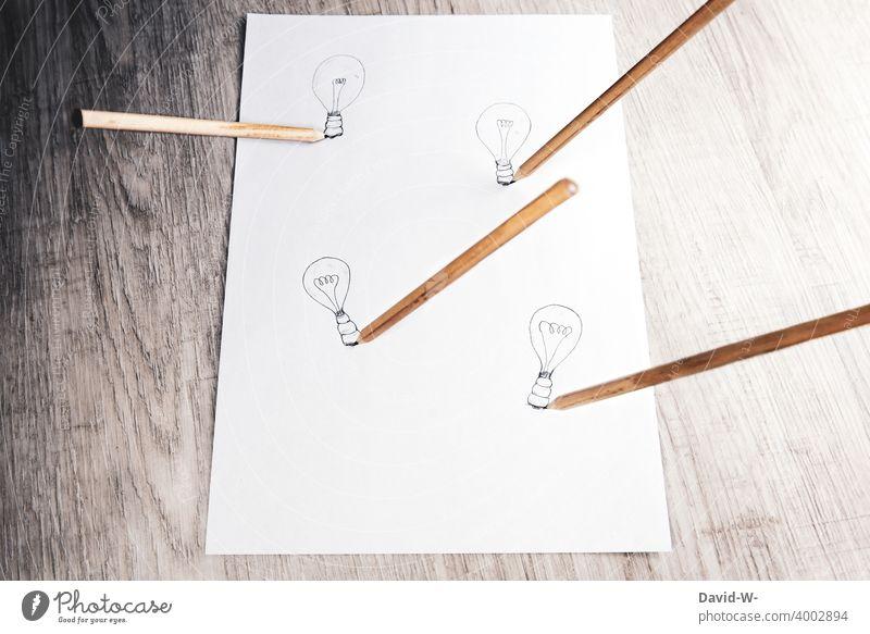 Ideen und Kreativität kreativ Einfall Lösung Erfolg erfolgreich Erfolgskonzept Glühbirne Stift Stifte lösungsvorschlag Zeichnung Schule lernen Bildung Denken