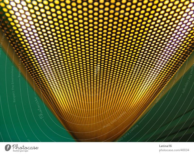 Loch an Loch grün gelb Wand Gitter Fototechnik