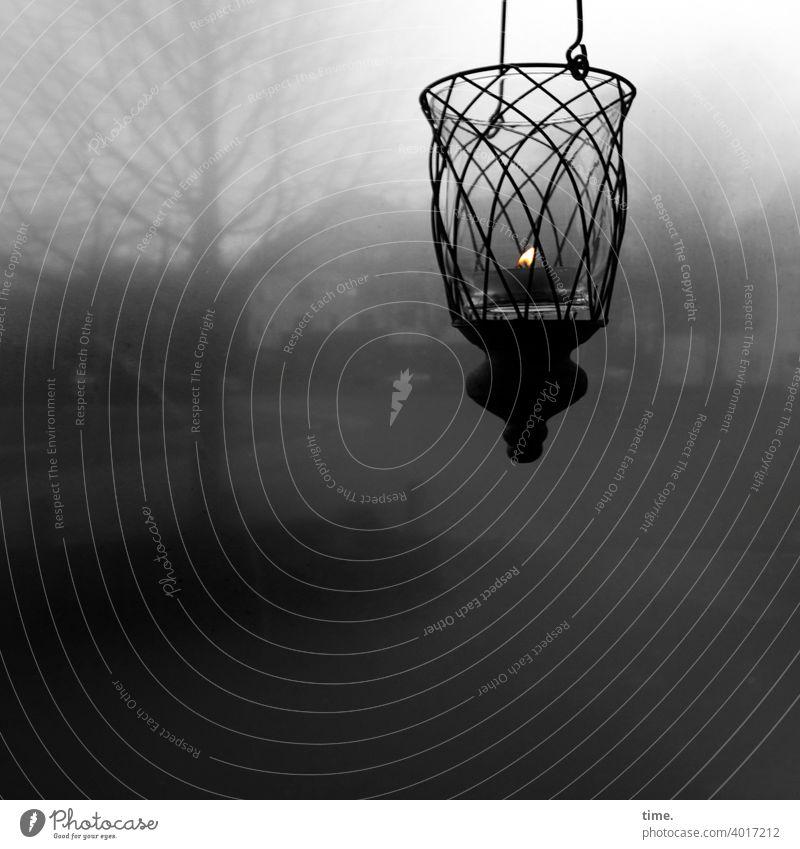 Trostlicht | corona thoughts Flamme Kerze hängen Kerzenhalter fenster grau unscharf hoffnung nebelig trüb haus baum verschwommen erleuchtung trost