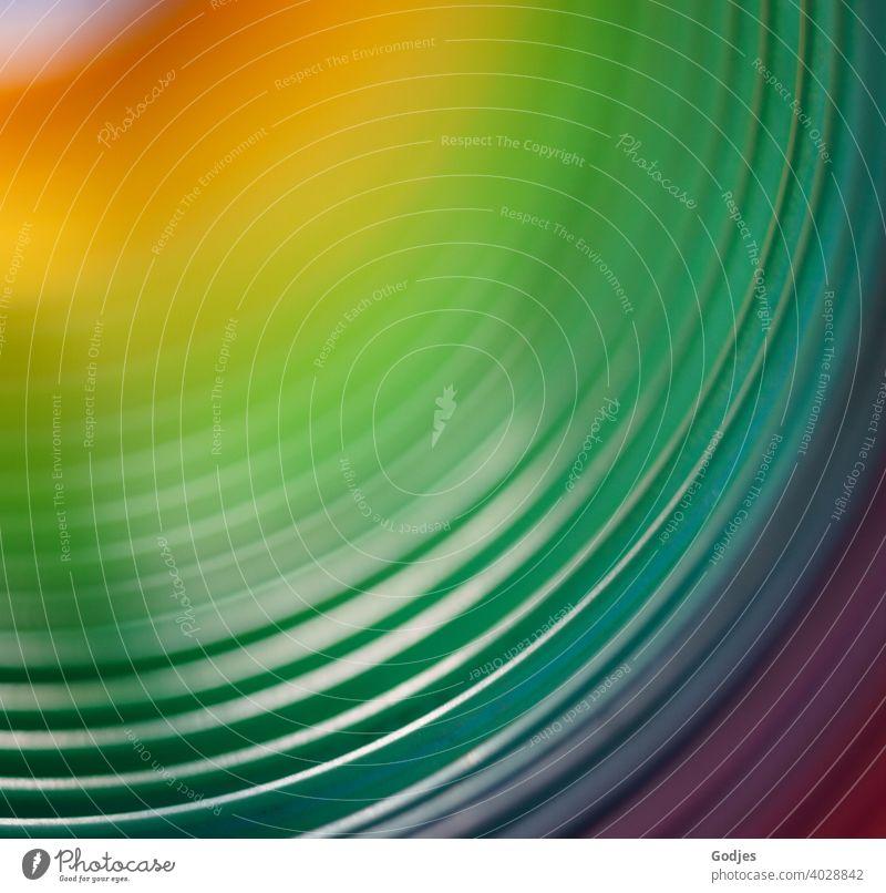 Background in Regenbogenfarben regenbogenfarben Farbe mehrfarbig Spektralfarbe Nahaufnahme Menschenleer Spirale Farbfoto rot blau gelb Licht spektral