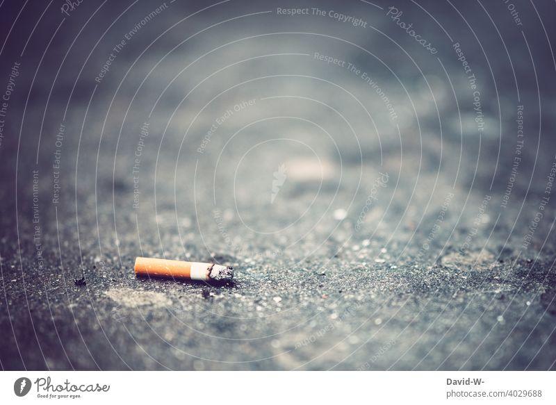 Zigarettenstummel liegt auf dem Boden rauchen liegen Müll weggeworfen Umweltverschmutzung Nikotin Abfall gesundheitsschädlich ungesund Gesundheitsrisiko