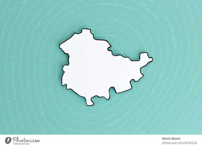 Bundesland Thüringen als Papier-Silhouette Deutschland Land Karte Papierschnitt minimalistisch Design neutral weiß abstrakt Grafik u. Illustration