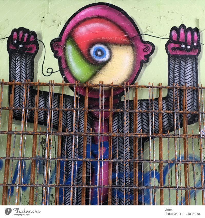 Geschichten vom Zaun (91) wand grafitti metallgitter abgestellt baumaterial rostig kunst auge farbenfroh bunt zeichnung gemälde zaun