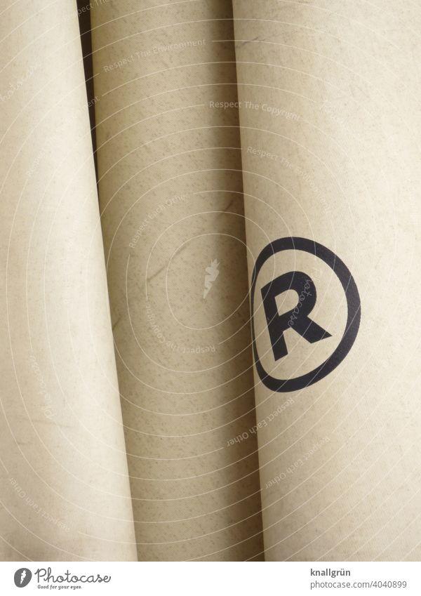 Registered Trademark Markenschutz eingetragenes Markenzeichen Warenzeichen Recht Kreis Zeichen Schilder & Markierungen Buchstaben Typographie Hinweisschild