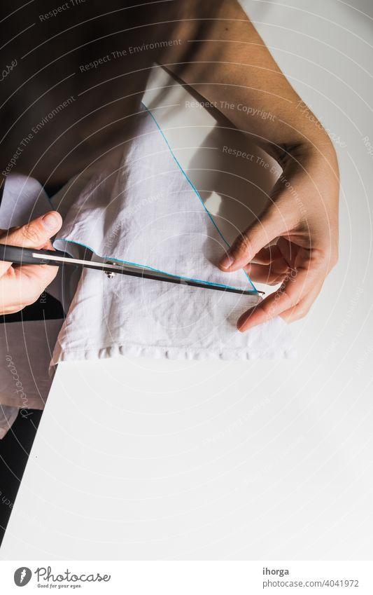 Frau Hand schneiden Stoff Gerät Atelier Handwerk geschnitten Design Detailaufnahme heimisch Damenschneiderin Damenschneiderei Gewebe Fabrik Mode Basteln
