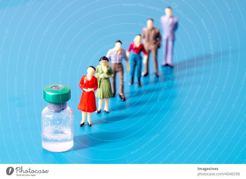 Massenimpfungen. Flasche mit Covid 19 Impfstoff Distanz abstrakt Erwachsene Hintergrund Geschäft Pflege Konzepte Ausschnitt Epidemie Ausrüstung Figur Krankheit