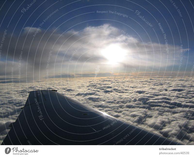 Flight002 Wolken Luftverkehr Tragfläche Abenddämmerung Flugzeug