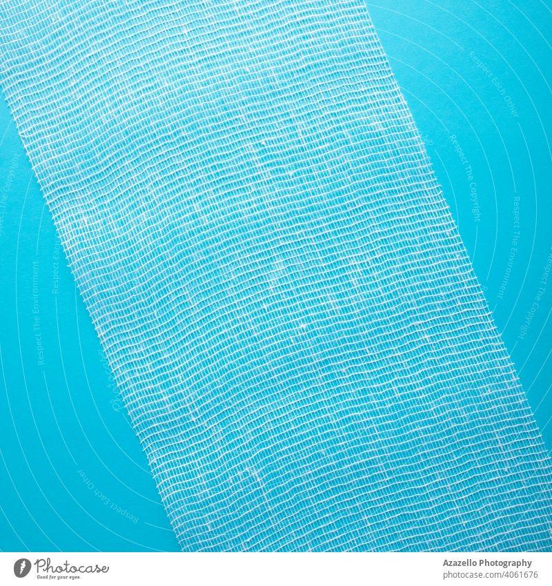 Steriler Bandagenhintergrund in blau. Unterstützung Krankenwagen Hintergrund bandagieren Pflege Seihtuch Sauberkeit Stoff komprimieren Baumwolle Dressing