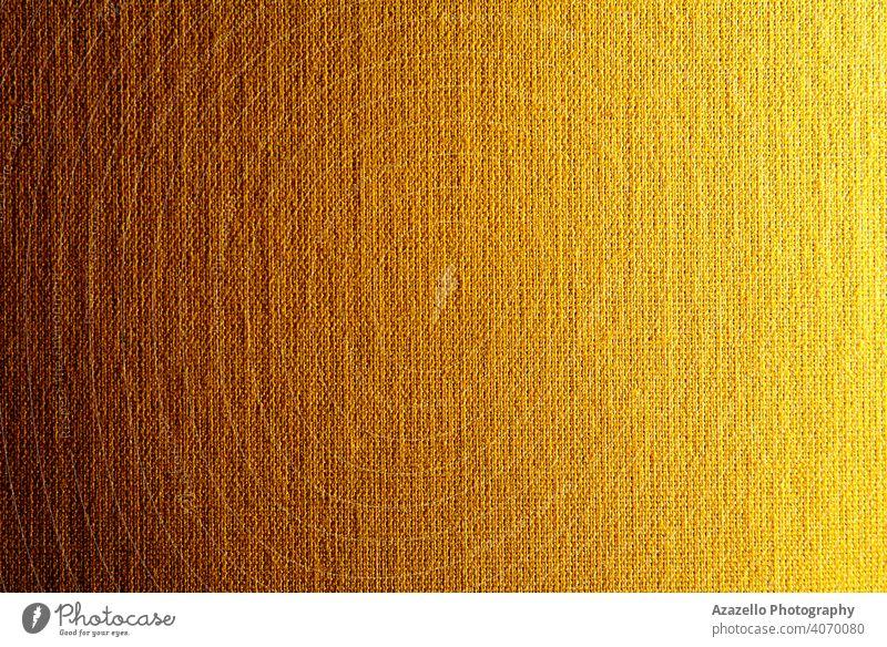 Gradiented Leinwand Textur in gelb-orange 2021 abstrakt Kunst Hintergrund braun Sackleinen Teppich Nahaufnahme Stoff Farbe Baumwolle Deckung
