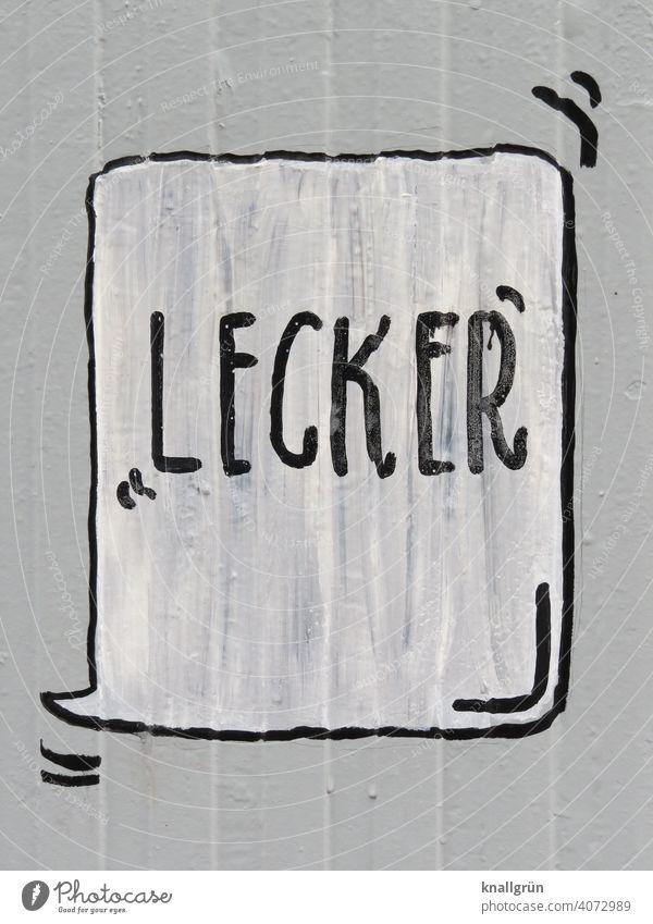 Lecker Sprechblase lecker Graffiti Schriftzeichen Tag sprechen Außenaufnahme Nahaufnahme Farbfoto weiß grau schwarz Kommunizieren Gedeckte Farben