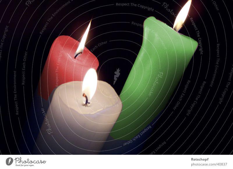 Italienische Kerzen farbige Kerzen brennende Kerzen Beleuchtung Flamme