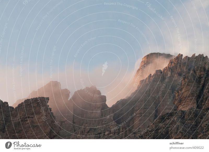 Mädchenwatte Umwelt Natur Landschaft Wolken Klima Klimawandel Wetter Schönes Wetter Nebel Felsen Alpen Berge u. Gebirge Gipfel gigantisch rosa Felswand